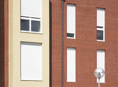 Red bricks facade with street lamp and windows — Stock Photo