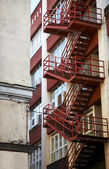 Red emergency staircase in a building facade — Stock Photo