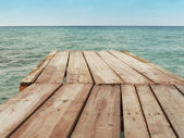 Wooden dock and Mediterranean sea with sky — Stock Photo