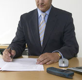 Detail of a business man with pen and papers — Stock Photo