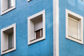 Concrete facade in blue tone with windows — Foto de Stock