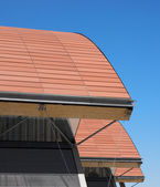 Modern building ceramic roof in orange tone — Stock Photo