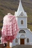 Iceland. Seydisfjordur. Traditional icelandic church and female  — Stock Photo