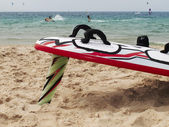 Surf board in the sand on a Mediterranean beach — Foto Stock