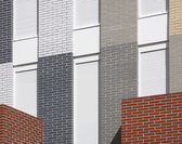 Modern building facade detail with multicolored bricks  — Stock Photo