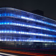 Modern building facade with blue light — Stock Photo #47882851