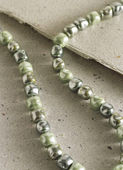 Necklace detail in green tones — Stock Photo