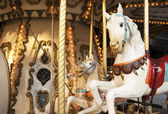 Merry-go-round with horses in warm tone — Стоковое фото