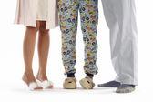 Family dressed in pyjama isolated on white — Stock Photo