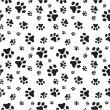 Stock Vector: Dog paws seamless pattern
