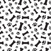 Dog bones and paws pattern — Stock Vector