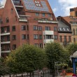 Apartment block with solar panels on the roof — Stock Photo #37299459