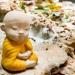 Monk meditation on the rock and small water fall — Stock Photo