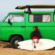 Surfer with his retro van — Stock Photo