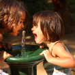 Two little girls smiling and playing outdoors — ストック写真