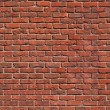 Seamless tile pattern of a clay brickwall - Stock Photo