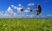 Boy playing soccer - clipping path — Stock Photo