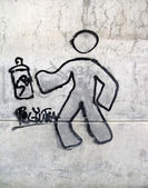 Graffiti displaying a man with a spray can — Стоковое фото