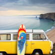Van and surf board at a beach - Stock Photo