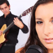 A female singer and a male guitarrist in action — Stock Photo