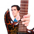 A male guitarrist in action — Stock Photo