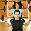 Stock Photo: Group having fun with weightlifting