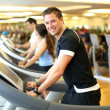 Man on treadmill smiling — Stock Photo
