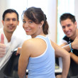 Group of three friends on treadmill giving thumbs up — Stock Photo #17591321