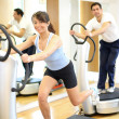 Woman on vibration plate in a gym - Stock Photo