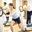 Womon vibration plate in gym — Stock Photo #17591343