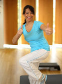 Woman having fun while doing aerobics — Stock Photo