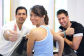 Group of three friends on treadmill giving thumbs up — Stock Photo