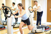 Woman on vibration plate in a gym — Stock Photo