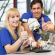 Dental technicians showing thumbs up — Stock Photo