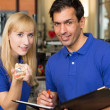 Apprentice and dental technician look at prosthesis — Stock Photo