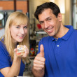 Dental technicians showing thumbs — Stock Photo #18766881