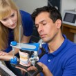 Two dental technicians with articulator — Stock Photo #18767381
