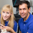 Two dental technicians choosing the right colour — Stock Photo #18767427