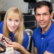 Two dental technicians choosing the right colour — Stock Photo