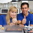 Two dental technicians showing thumbs up — Stock Photo #18767463