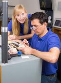 Apprentice watching dental technician — Stock Photo