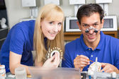 Two dental technicians choosing the right colour for dental porc — Stock Photo