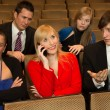 Woman in the audience annoying others with a cellphone — Stock Photo #20095403