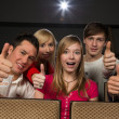 Happy in movie theatre — Stockfoto