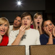 Happy in movie theatre — Stock Photo