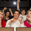 Audience in cinema cheering — Stock Photo