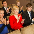 Theatre audience clapping and cheering — Stock Photo