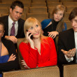 Womin audience annoying others with cellphone — Stock Photo #20095403