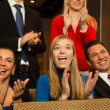 Theatre audience clapping and cheering - Stock Photo