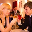 Stock Photo: Couple in love enjoying drinks